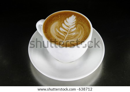 Cappuccino with latte art - stock photo