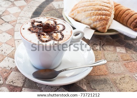 cappuccino with pastry - stock photo