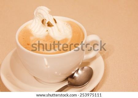 Cappuccino with soft cream - stock photo