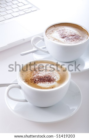 cappuccinos and laptop - stock photo