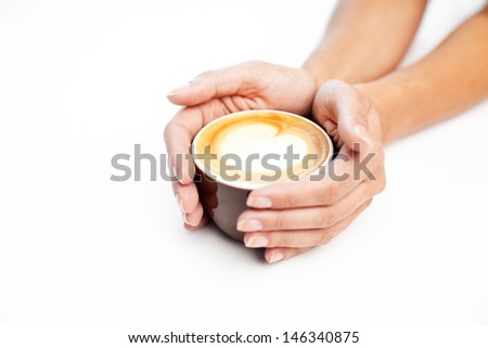 Cappucino with heart symbol - stock photo