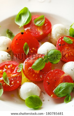 Caprese salad, mini mozzarella, cherry tomato and basil