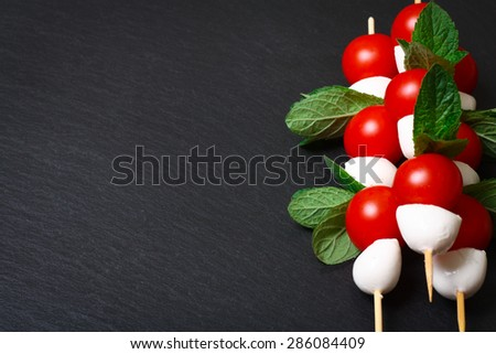Caprese salad on sticks - stock photo
