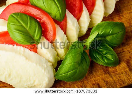 caprese salad with mozzarella cheese, basil and tomatoes - stock photo