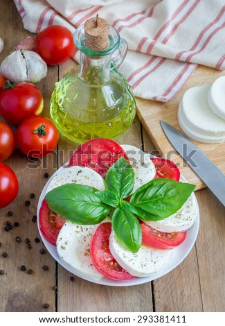 Caprese salad with tomatoes, basil and mozzarella - stock photo
