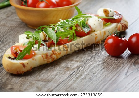 Caprese sandwich of mozzarella cheese, tomato and basil - stock photo
