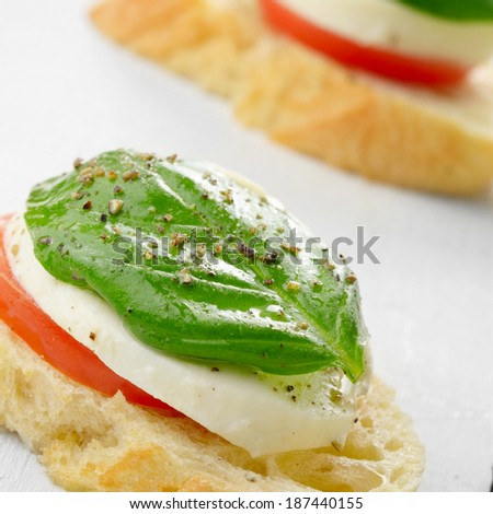 Caprese sandwiches of mozzarella tomato and basil