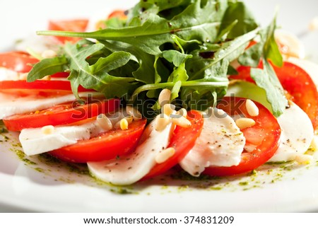Caprese with Rocket Salad - stock photo