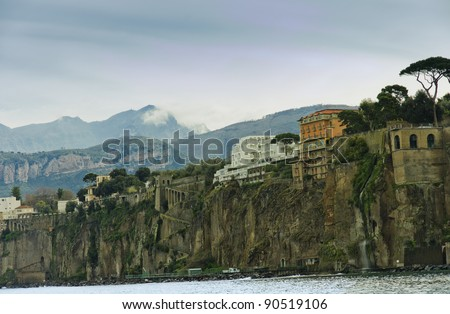 Capri by a cloudy day. (Part of Campania), Bay of Naples ,southern Italy. Tourist attraction noted for its beautiful scenery and luxurious  houses.
