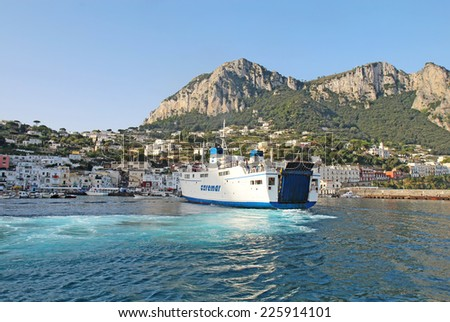 CAPRI, ITALY - OCTOBER 10 2014: Caremar ferry Naiade arriving at Marina Grande on the isle of Capri. Ferries provide transport of passengers and vehicles to many destinations in the Gulf of Naples. - stock photo