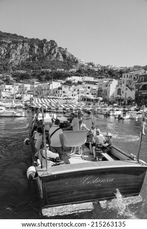 CAPRI, ITALY - 25th of August 2014: Unknown tourists on the boat in Capri on 25th of August 2014 in CAPRI, ITALY (black and white)