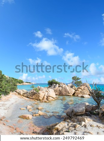 Capriccioli beach under a cloudy sky. Shot in Sardinia, Italy - stock photo