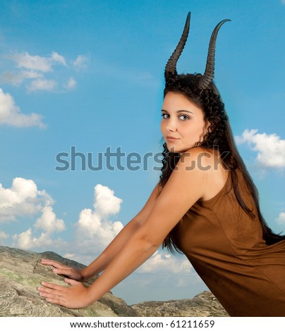 Capricorn or Goat woman, this photo is part of a series of twelve Zodiac signs of astrology - stock photo