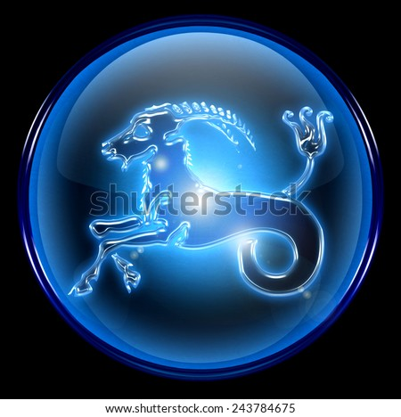 Capricorn zodiac button, isolated on black background. - stock photo