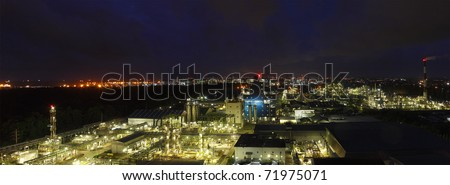 Caprolactum petrochemical plant in panorama view at night time