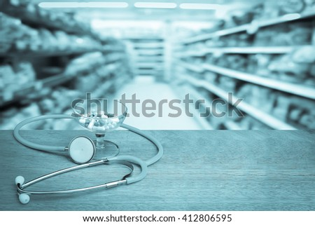 capsule and  stethoscope with blur shop background