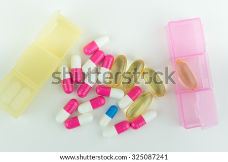 capsule medicine, pills, pink white blue, with portable compartment - stock photo