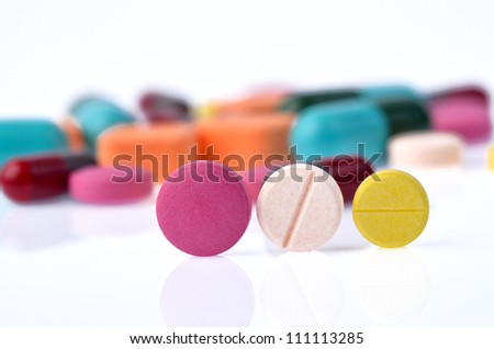 capsule pills isolated on white background - stock photo