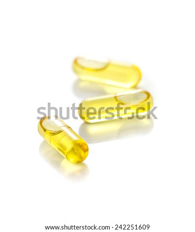 capsules from Fish Oil on white background - stock photo