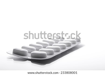 Capsules in blister pack - stock photo