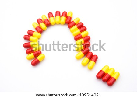 capsules line up as a question mark - stock photo