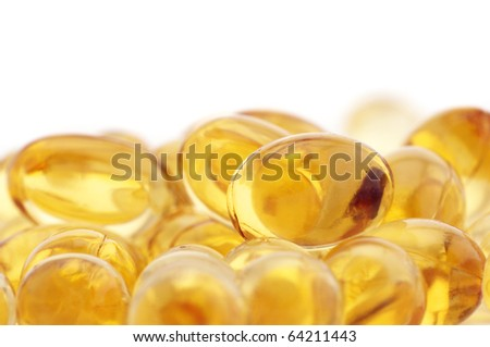 Capsules of fish oil and vitamins on white background. - stock photo