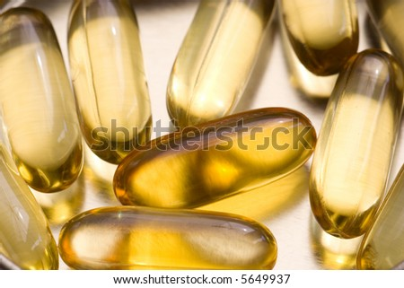 Capsules On A Tin Background