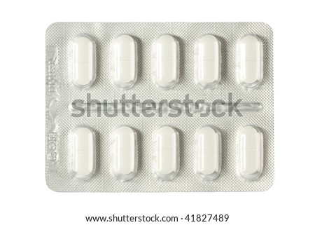capsules packed in blister, isolated - stock photo