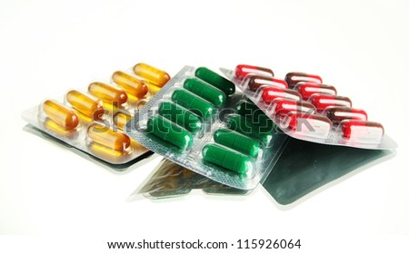 Capsules packed in blisters, isolated on white