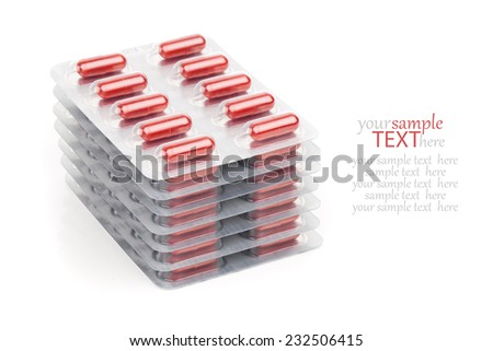 Capsules packed in blisters isolated on white close-up - stock photo