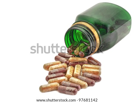 Capsules Pills Medicine with green bottle - stock photo