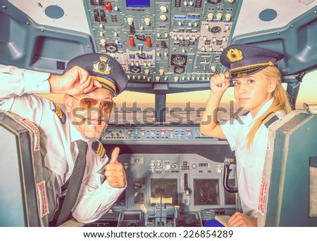captain and copilot. concept about airplane service and occupation - stock photo