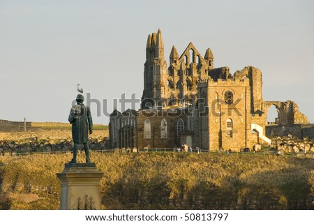 Captain Cook's Monument overlooking Whitby with Saint Mary's church and Whitby Abbey in the background.  Whitby, North Yorkshire, England, UK - stock photo
