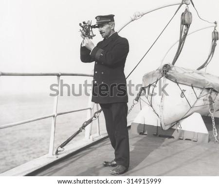 Captain navigating ship - stock photo