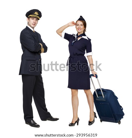 Captain of the aircraft and a beautiful flight attendant in a dark blue uniform, isolated on white background - stock photo
