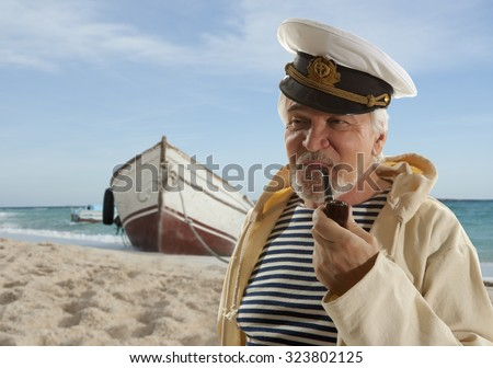 Captain. Sailor man in marina port with boats background  - stock photo