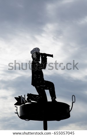 Captain with binoculars as a signpost