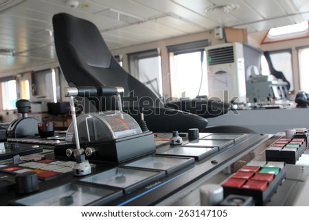 Captains seat on the bridge of a ship - stock photo