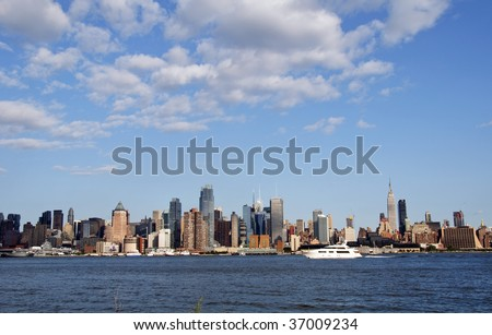 capture of nyc over hudson blue sky - stock photo