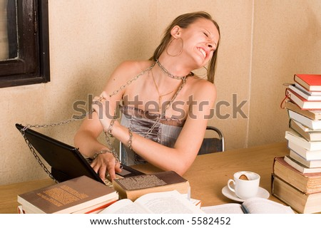 Captured business woman with chain and laptop - stock photo