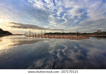 Capturing the cloud reflections in the water at Narrabeen Lakes entrance on the Northern beaches, Sydney.