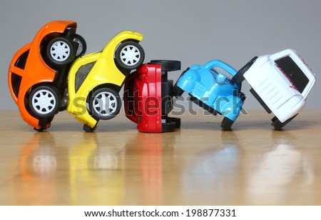 Car Accident concept image with colorful miniature cars - stock photo