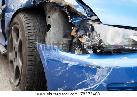 car accident, damaged vehicle after crash staying on the street - stock photo