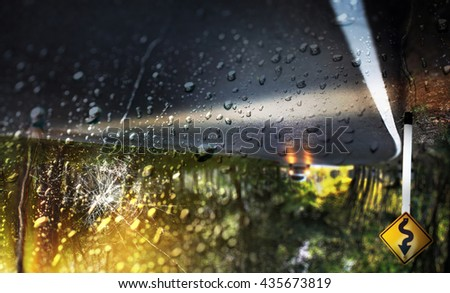 Car accident on heavy rainy day.View through the broken windshield. - stock photo