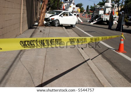 car accident scene with sheriff line do not cross yellow tape - stock photo
