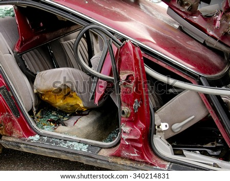 Car accident showing twisted metal and broken glass - stock photo
