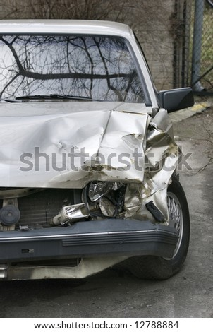 car after crash on road - stock photo