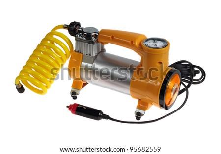 Car air compressor with yellow twisted hose  isolated on a white background - stock photo