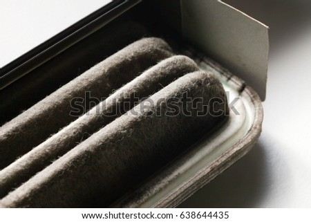 Car air filter part in used and old condition.