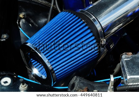 Car air filter zero resistance. element of a sports car tuning. photo toned. - stock photo